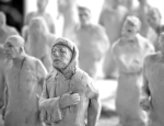 Figurines representing refugees